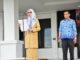 dr. Hj. Nikmat B.Situru, M.Ap saat memimpin upacara.