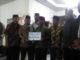 Foto bersama seusai penyerahan bantuan.