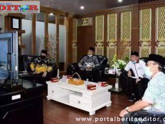 Bupati Musi Rawas, H.Hendra Gunawan mendengarkan Penyampaian BPK RI perwakilan Provinsi Sumatera Selatan Mura Meraih WTP ke 4 kalinya.