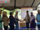 Penyerahan bantuan untuk korban bencana galodo Nagari Guguak Malalo.