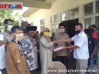 Penyerahan bntuan dana covid di Nagari Lubuk Gadang Timur.