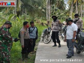 Kapolsek Sipora Dampingi Camat Sipora Lakukan Evaluasi di Desa Batumonga