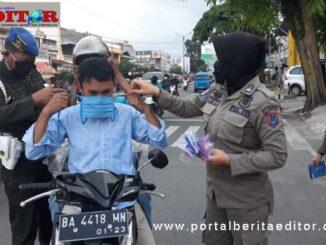 Upaya penertiban warga yang abai terhadap protokol kesehatan oleh tim gugys tugas covid Payakumbuh.