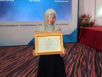 Nora Martini masuk 5 besar memperoleh penghargaan GTK PAUD dari Kemendikbud.