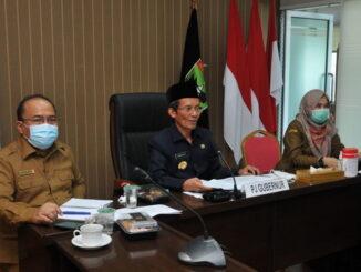 Pj. Gubernur Sumbar, Hamdani saat rakor virtual denngan Bappenas.
