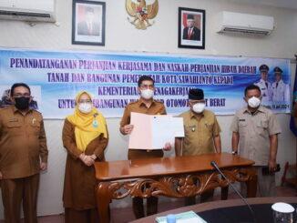 Penandatanganan Perjanjian Kerjasama dan Naskah Perjanjian Hibah Tanah dan Bangunan Pemko Sawahlunto kepada Kementerian Tenaga Kerja RI.